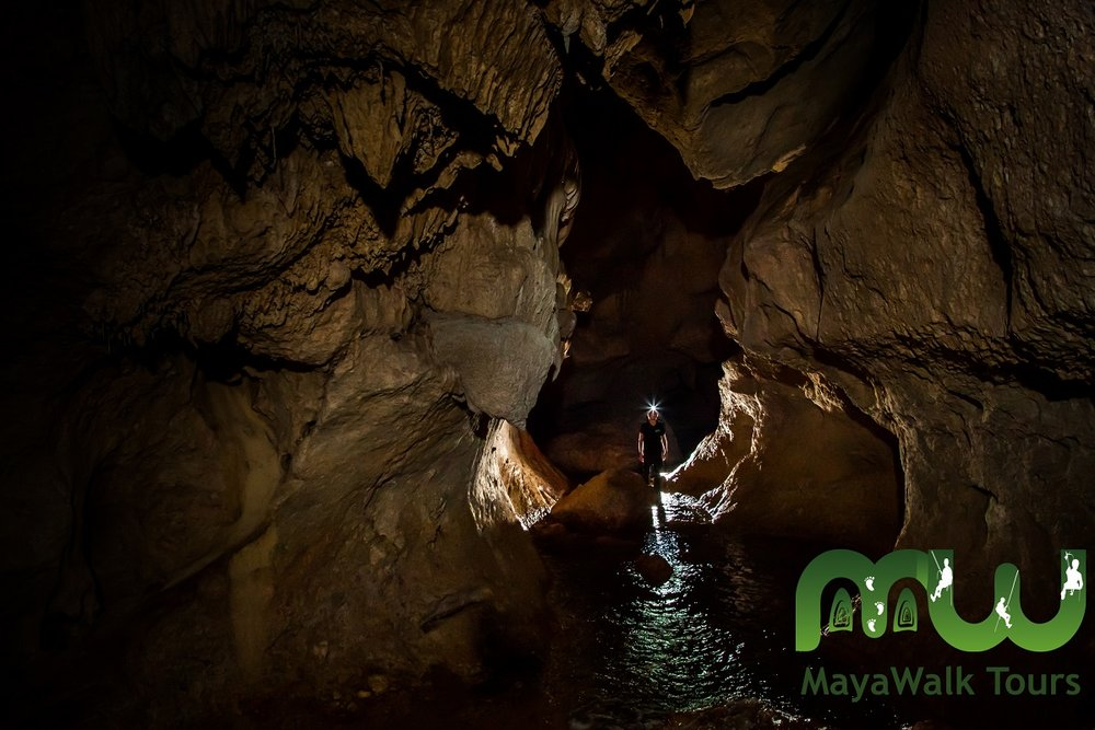 explorer in the Actun Tunichil Muknal or ATM Cave, Belize