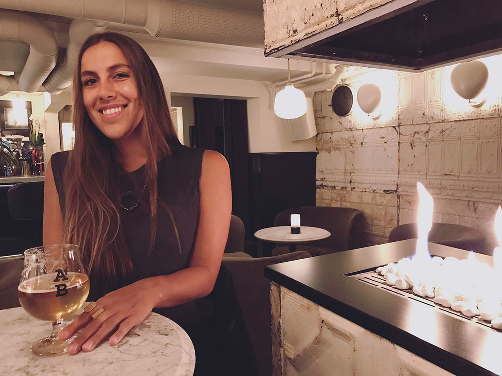 Sapphire & Elm Travel co-founder,  Stephanie , enjoying a beer at underbar in oslo