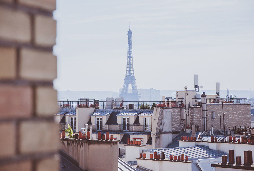 view of the Eiffel Tower from rooftops | Paris Neighborhoods Explained